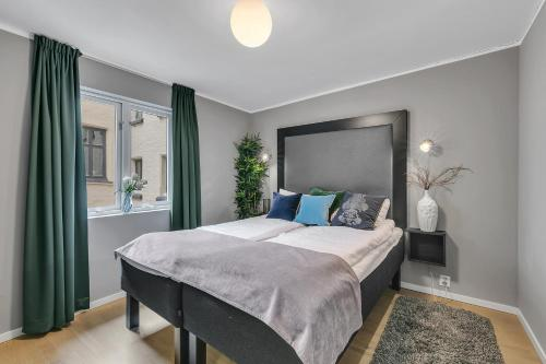 A bed or beds in a room at Forenom Serviced Apartments Oslo Opera