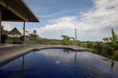 The swimming pool at or near Medewi Snaffl Beach Villa