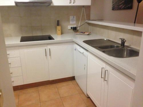 A kitchen or kitchenette at Crown Towers Resort
