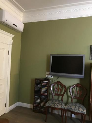 Телевизор и/или развлекательный центр в Квартира Люкс
