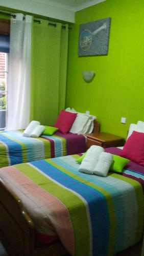 A bed or beds in a room at Residencial Moeda