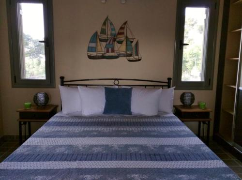 A bed or beds in a room at Maniata Holiday Apartments