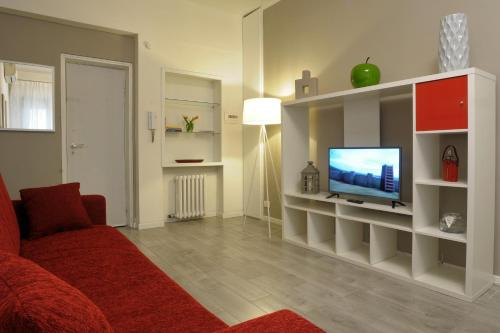 A television and/or entertainment centre at Filarmonico12