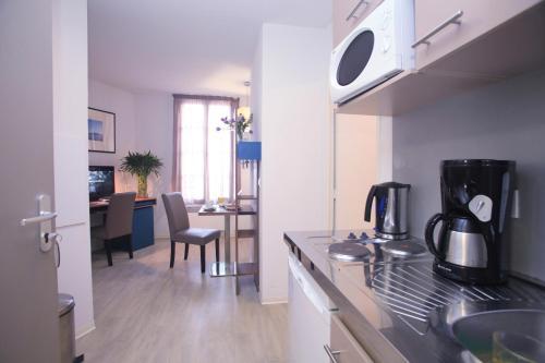 Cuisine ou kitchenette dans l'établissement Odalys City Marseille Canebière