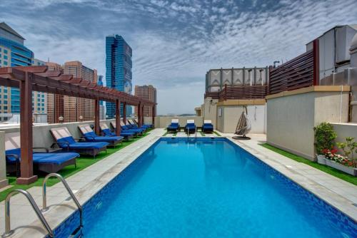 The swimming pool at or near Class Hotel Apartments