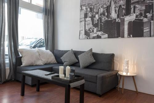A seating area at New Rijn Apartment