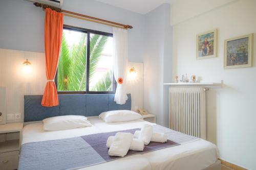 A bed or beds in a room at Dionisos Palms Apartments