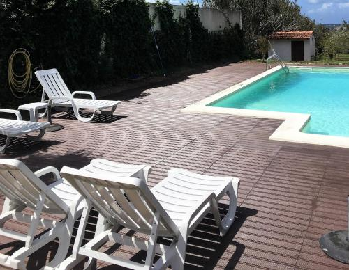 The swimming pool at or near A Casa Dos Avós