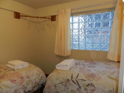 Cama o camas de una habitación en Cherry Cusco
