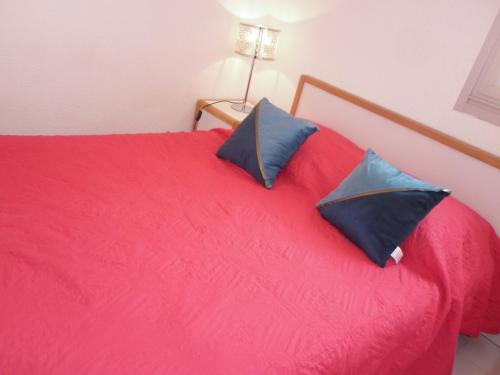 A bed or beds in a room at Aqua Plage