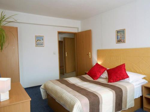 Łóżko lub łóżka w pokoju w obiekcie Hotel As