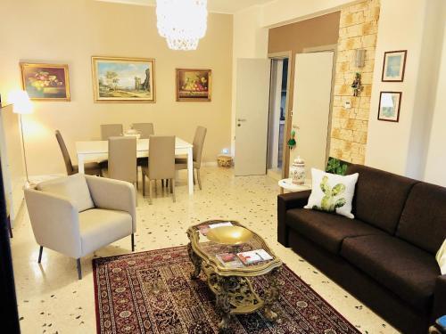 Area soggiorno di Dimora Umberto Home - Piazza Cavour