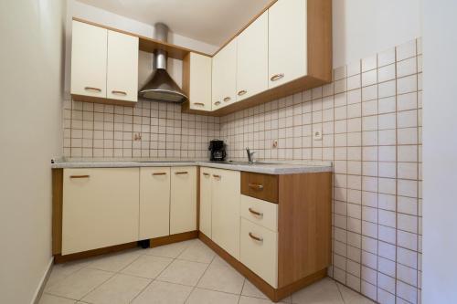 A kitchen or kitchenette at Apartments Kori