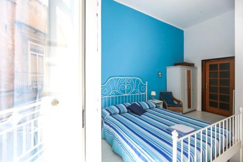 Кровать или кровати в номере Camera Con Vista Apartments