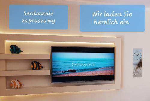 Telewizja i/lub zestaw kina domowego w obiekcie Apartment Beach