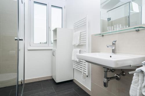 Ein Badezimmer in der Unterkunft IG City Apartments Campus Lodge