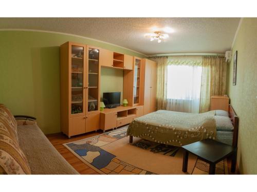 Кровать или кровати в номере Рядом Буртасы