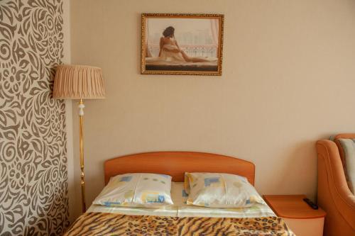 Кровать или кровати в номере Kardiotsentr & Burtasy