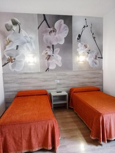 A bed or beds in a room at Hotel Yeste