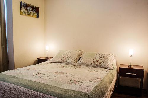 Cama o camas de una habitación en Departamentos Alto Moneda