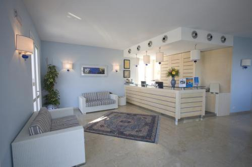 The lobby or reception area at Villaggio Cala La Luna