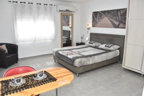 A bed or beds in a room at Sweet Dreams Apartment