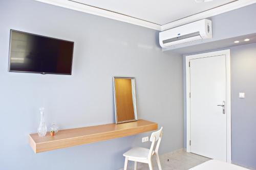 تلفاز و/أو أجهزة ترفيهية في Alkyoni City Apartment