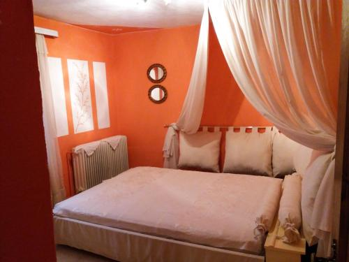 A bed or beds in a room at Proia's Guesthouse 7km from Meteora!At village VLACHAVA