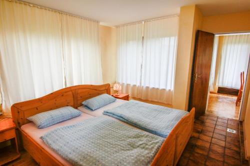 Ein Bett oder Betten in einem Zimmer der Unterkunft Gesundheitshaus Rittmeyer