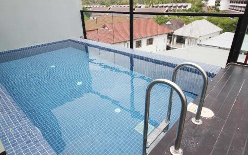 The swimming pool at or near Unique Loft Apartment