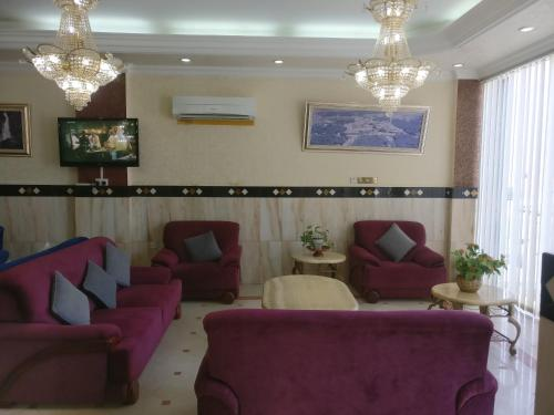 A seating area at Gulf Hotel Apartment