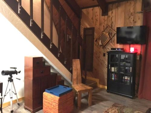 A television and/or entertainment center at The Bear's Den Chalet