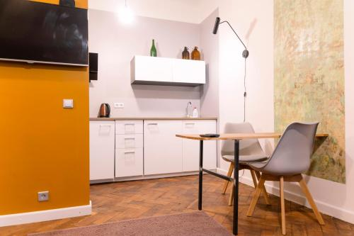 A kitchen or kitchenette at Baltic Design Apartments