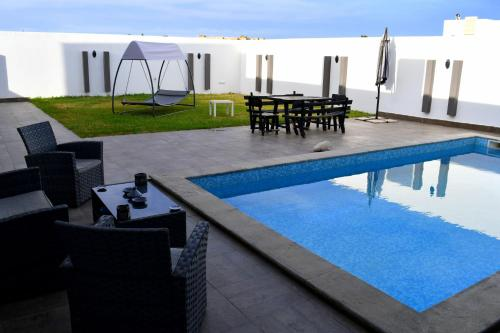 The swimming pool at or near Limo's House