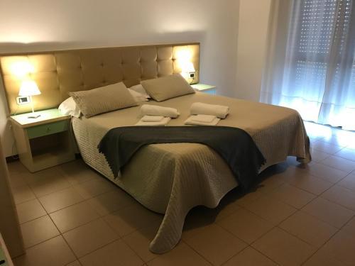 Postel nebo postele na pokoji v ubytování Residence Viale Venezia