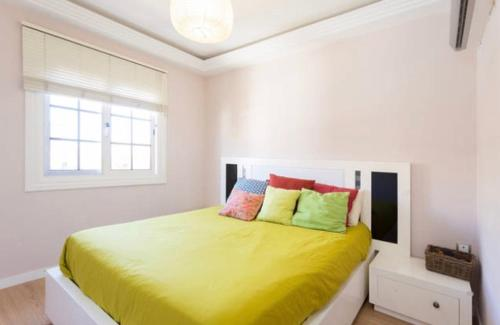 A bed or beds in a room at Holidays home
