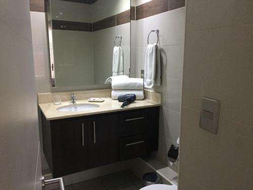 Un baño de Providencia PRO Apart Hotel