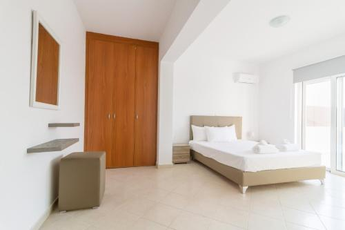 A bed or beds in a room at Casa Marinella