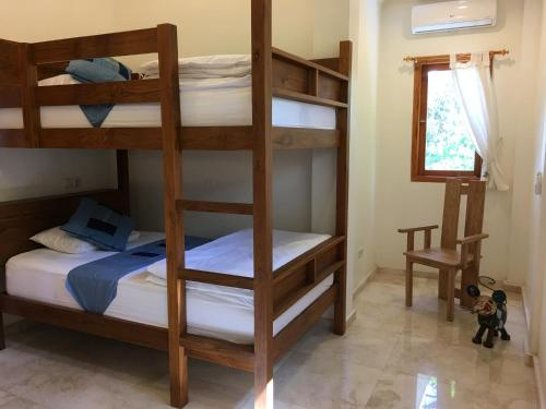 A bunk bed or bunk beds in a room at Paradise West-Bali