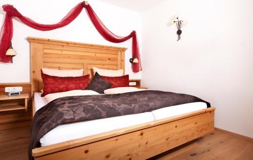 Ein Bett oder Betten in einem Zimmer der Unterkunft Ferienhaus und Landhaus Berger