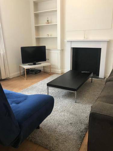 A television and/or entertainment center at Marylebone High Street Apartment