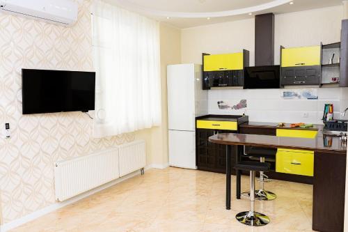 """Televízia a/alebo spoločenská miestnosť v ubytovaní Studio """"Favorit"""""""