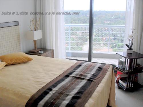 Cama o camas de una habitación en Torre 360 Punta del Este