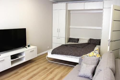Кровать или кровати в номере Apartamenty v Svetlogorske