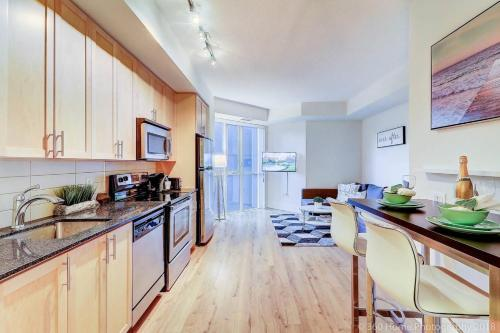 A kitchen or kitchenette at Lux Suites In The Heart Of King West