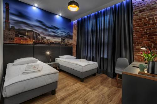 A bed or beds in a room at Aparts Loft Bed&Breakfast