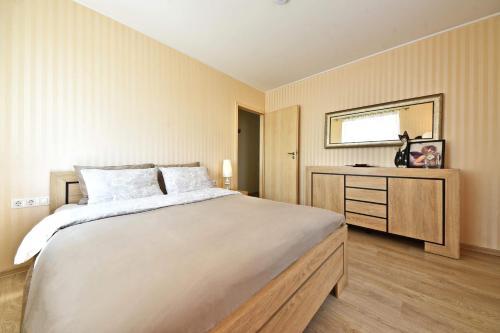 מיטה או מיטות בחדר ב-Apartamentai Kaunas