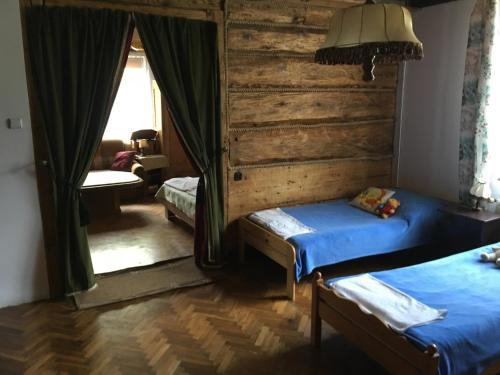 A bed or beds in a room at Apartments Sanok