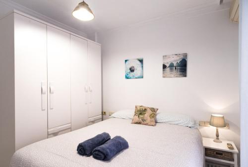 A bed or beds in a room at EL CORAZÓN DEL CENTRO DE SEVILLA