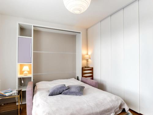 A bed or beds in a room at Apartment Clos Savignac